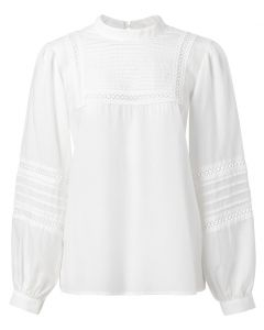 Shirt with embroidered tape
